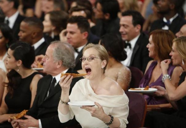 Meryl Streep chowing down,pretty gracefully, I might add.