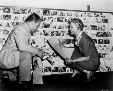Peggy Lee and Oliver Wallace working on the music to Lady and the Tramp.